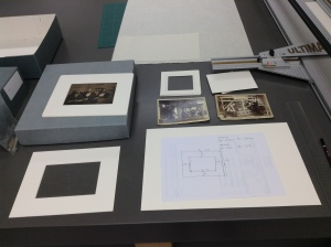 Creating mounts for two photographs. Photograph by Amy Walsh.