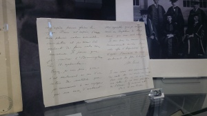 Marie Curie's letter to Sir Oliver Lodge. This is the letter I helped prepare for the exhibition, which included tape removal, flattening and mounting. Photograph by Amy Walsh.